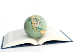 world globe on a open book on white background